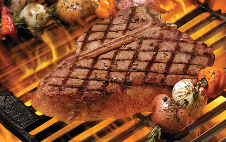 Porterhouse steak on flaming grill