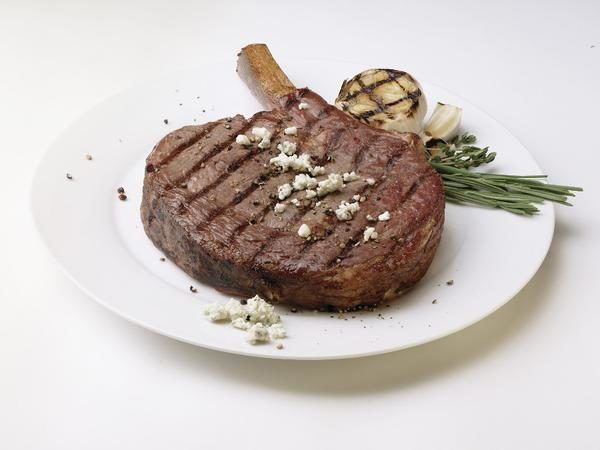 Grilled Bone-In Ribeye topped with blue cheese crumbles