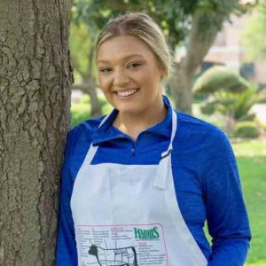 Model wearing Harris Ranch Beef Cuts Apron
