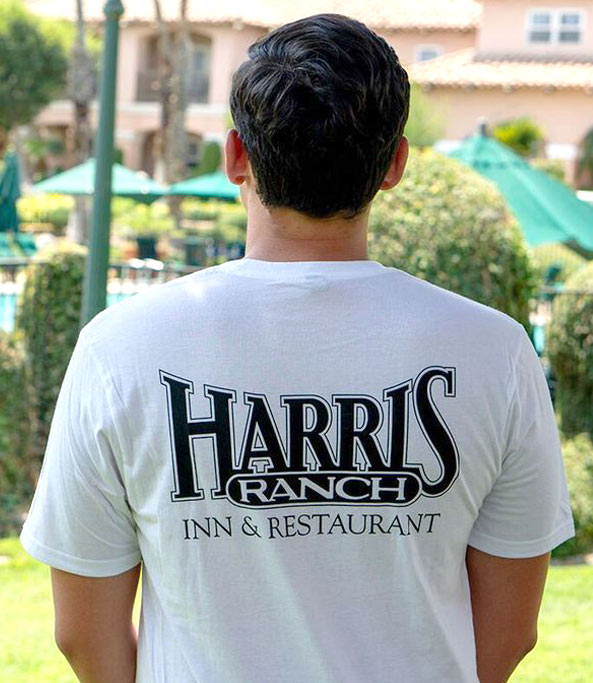 Model wearing Harris Ranch T-Shirt (back view)