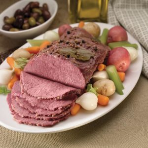 Corned beef on plater with raw vegetables
