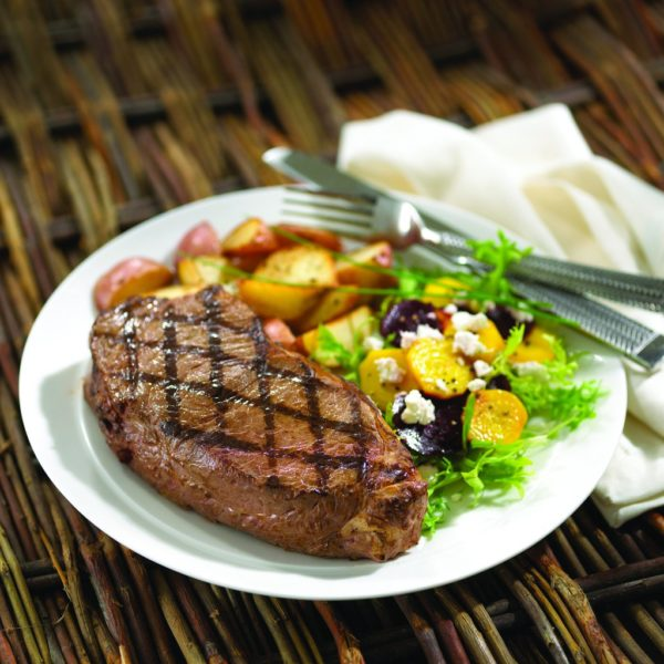Grilled New York Steak with roasted red potatoes and mixed green salad with grape tomatoes