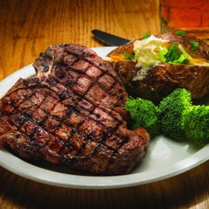 Grilled Porterhouse steak with broccoli and loaded baked potato and beer