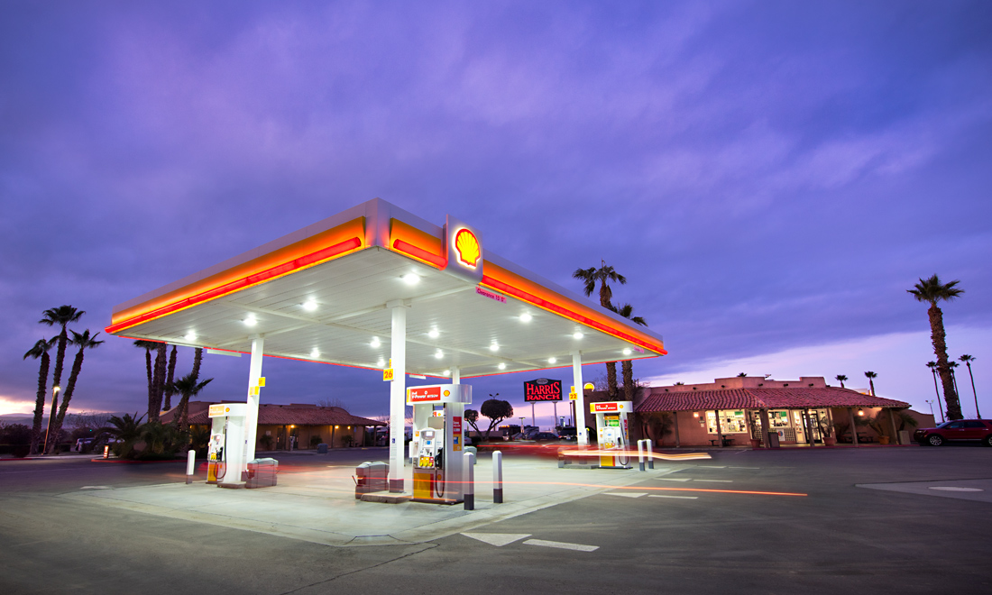 Shell gas station at Harris Ranch. Lit up brightly at dusk.