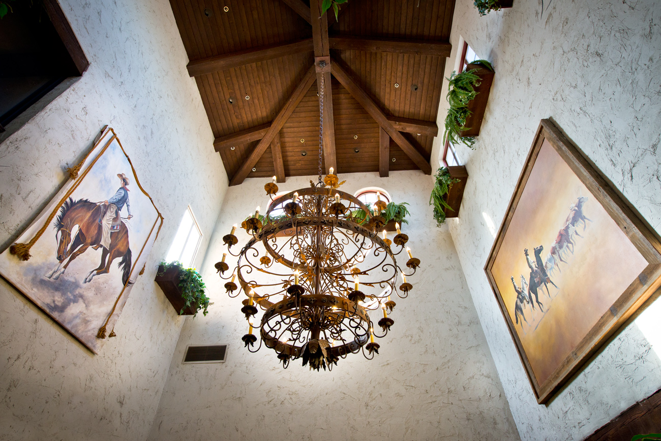 Chandelier and exposed wood ceiling at Harris Ranch