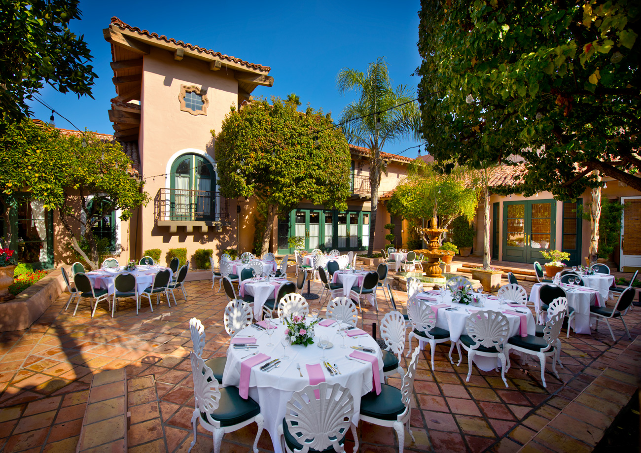 Outdoor courtyard with tables set for a banquet