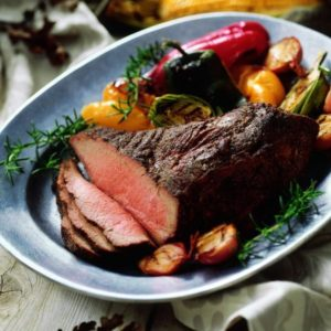 Tri-tip on platter with roasted vegetables