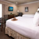 Deluxe Double Queen guest room at the Harris Ranch Inn. Western=themed decor