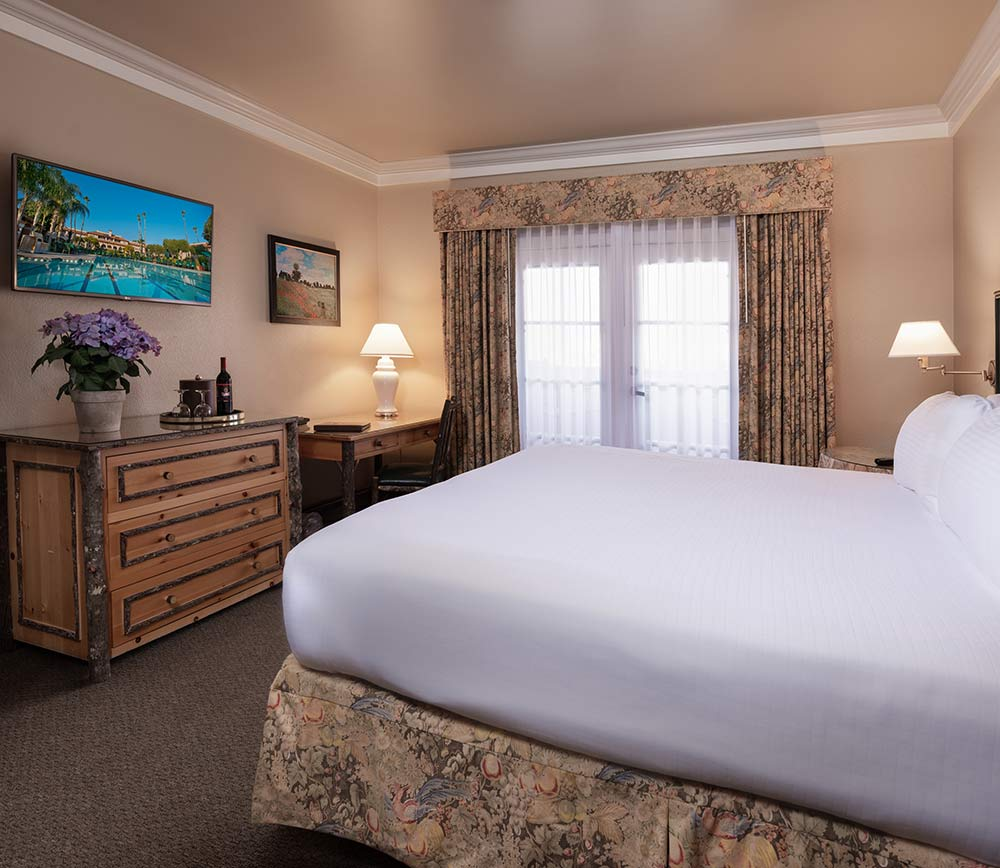 Executive Suite at Harris Ranch Inn. View of bedroom with doors leading to the patio
