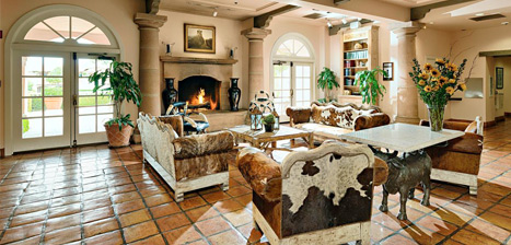 Lobby of the Harris Ranch Inn. Tile floor, Western-style furnishings, plants and sunflowers