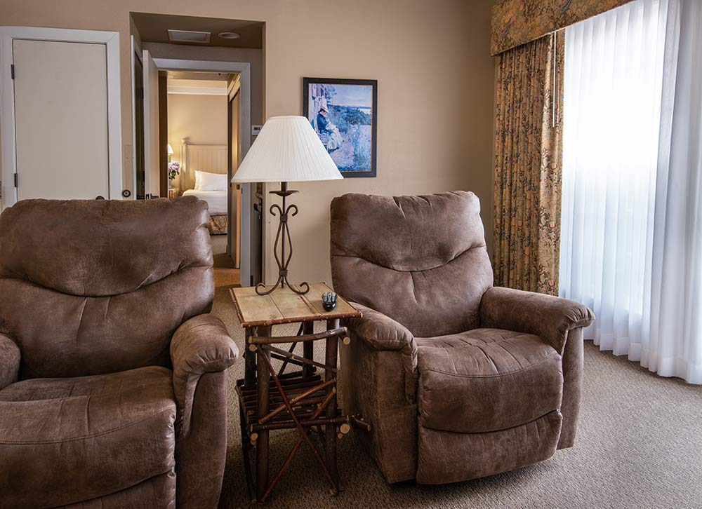 Triple Crown Executive Suite. Matching over-stuffed chairs with side table