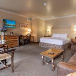 Luxury Suite at the Inn. Crisp white bedding, Western-style furniture