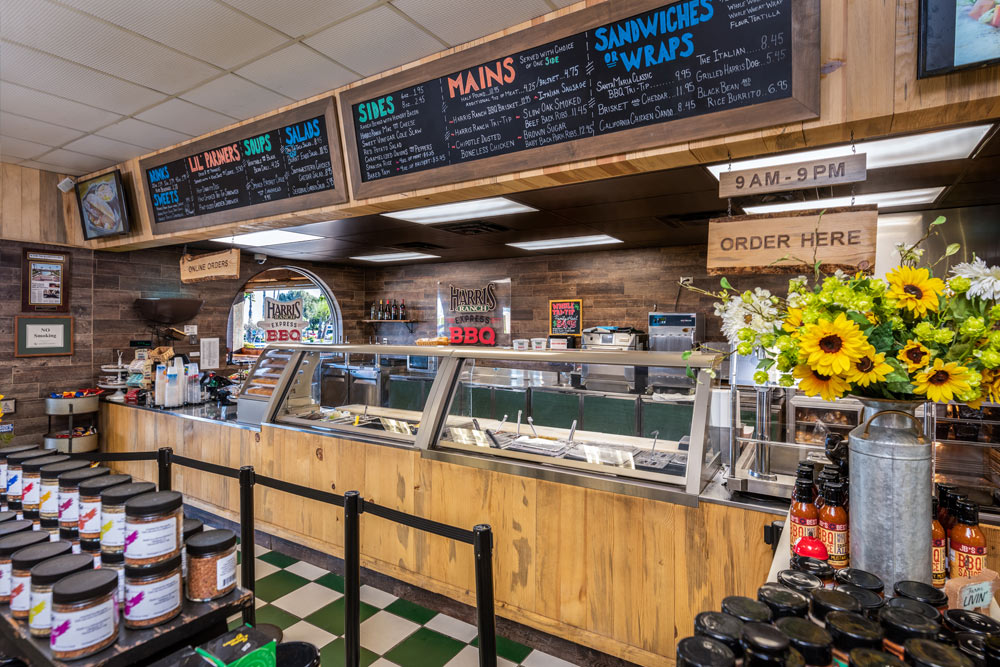 BBQ Express counter with Menu Board above. Fresh flowers beside ordering counter with sign reading 9 a.m. - 9 p.m. Order Here