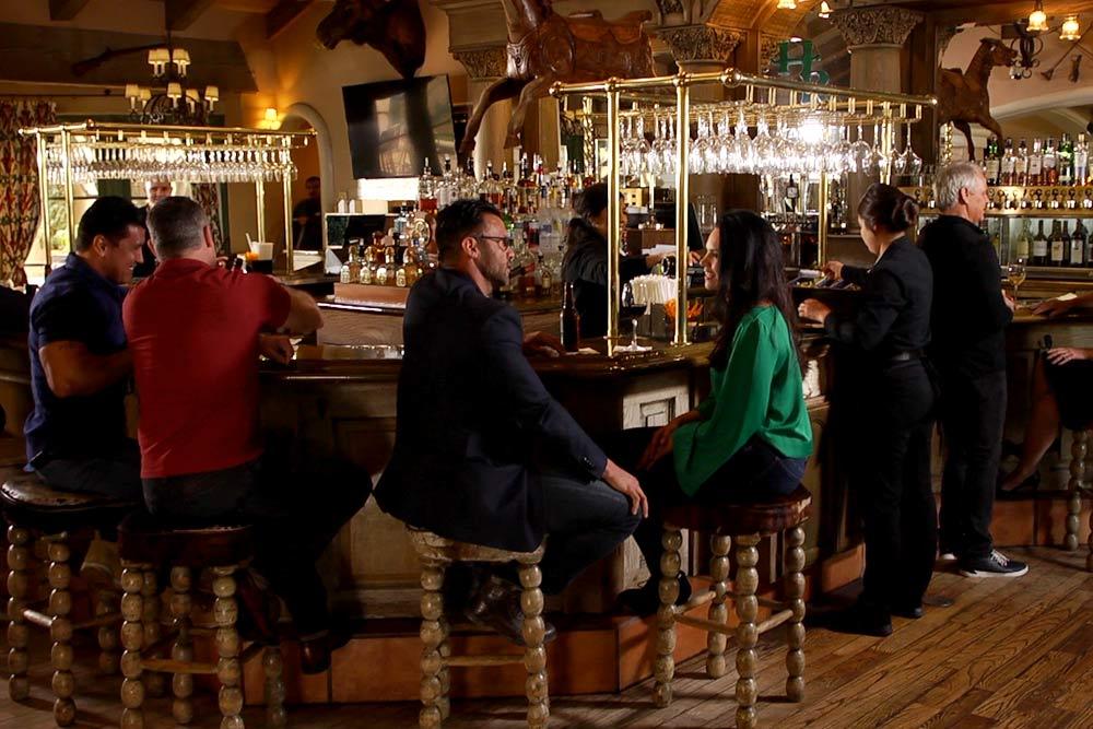 Vistors enjoying the Horseshoe Lounge, seated at barstools