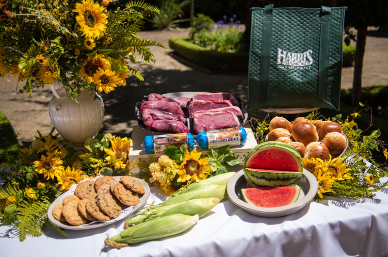 Grand Slam Package, includes premium beef, rolls, corn, fruit and cookies