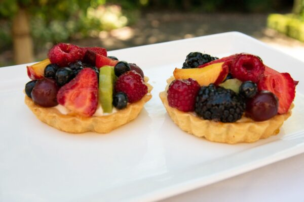 Individual Assorted Fruit Tart with berries, kiwi, and peaches