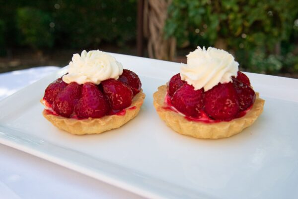 Individual Strawberry Fruit Tart topped with whipped cream