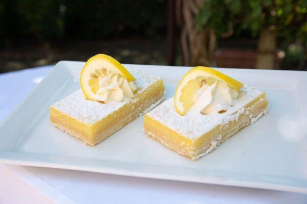 Lemon Bar topped with fresh lemon slice